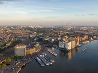 Aerial view of central part of Amsterdam, new district of IJdock and canal cruise ships, Netherlands