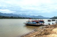 Ferry raft loading motorbike Mekong River, Laos