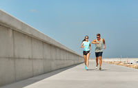 couple in sports clothes running outdoors
