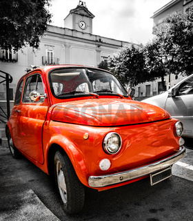vintage red italian car old selective color black and white italy town