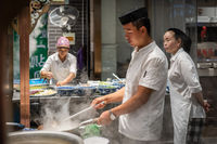 Chinese chef preparing hot food