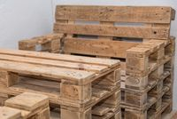 rustic furniture made of wooden pallets - sustainability solid wood furniture upcycling