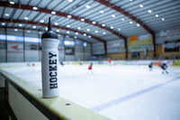 drink bottle on board ice hockey rink
