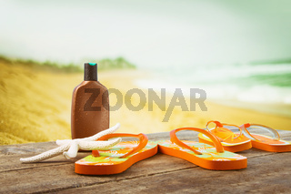 Sunbathing accessories placed on wooden planks at the beach