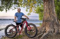 senior man with a fat mountain bike