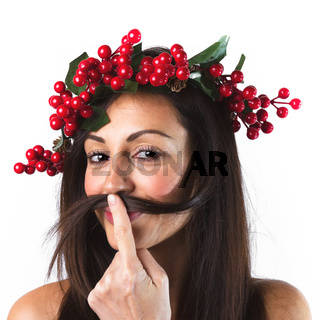 Woman with a christmas wreath