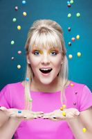beautiful blond girl with many colorful candies