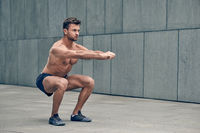 Fit muscular young man working out in town