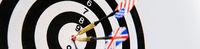 Dartboard with two darts in a bullseye