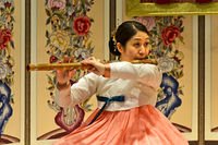Woman playing the traditional daegeum bamboo transverse flute, Seoul, South Korea