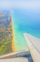 algarve coast seen from aircraft window approaching faro airport