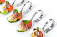 Fish appetizers on spoon