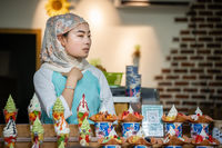Muslim woman selling desserts