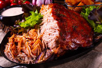 delicious pulled pork with baked potato quarters