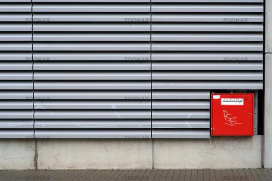 Extinguishing water feed on modern corrugated iron facade