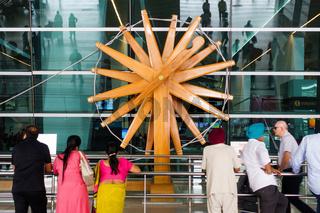 Wood charkha (spinning wheel) at New Delhi International Airport