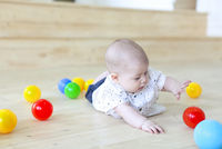 Baby boy playing with balls. Kid in play room. Toddler kid with balls  for children.