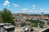 Fribourg, FR / Switzerland - 30 May 2019: view of the historic city of Fribourg with tourists relaxi