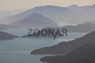 Fogy day in the Marlborough Sounds, New Zealand. Bay and hills.
