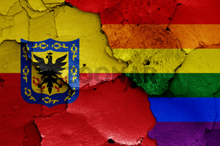 flags of Bogota and LGBT painted on cracked wall