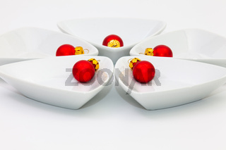 Ceramic bowls for sushi food and red Christmas decoration