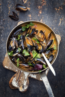 Traditional French blue mussel in bouillabaisse as top view in a casserole