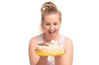 Funny fat blonde with a cake isolated shot