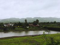 View of Balaji Resort, Kanandi river and the bridge at Velhe in Monsoons, Pune district, Maharashtra.