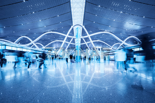 passenger movement blur in busy airport terminal