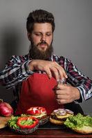 Man cooking burger