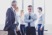 Coworkers having business conversation