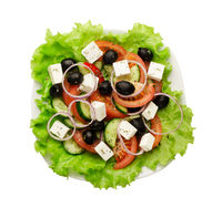 Greek salad of fresh cucumber, tomato, sweet pepper, lettuce, red onion, feta cheese and olives with olive oil