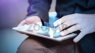 businessman interacts with hologram chart on a tablet