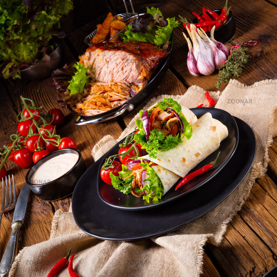 Tasty wraps filled with pulled pork and salad