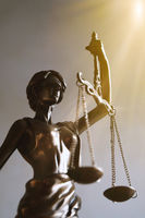 lady justice or justitia figurine law and legal symbol