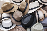 Background from a heap of different panama hats.