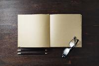 Book, glasses, pencils