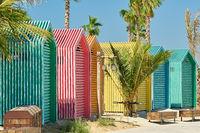 Colored beach bathing cabins in Dubai