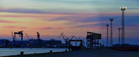 Silhouettes at the port of Rostock at sundown
