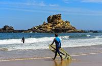 Surfer at theamPraia do Castelejo beach at the Costa Vicentina coast, Vila do Bispo, Portugal