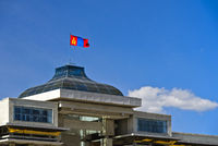 National flag of Mongolia with the Soyombo national symbol on the Parliament building, Mongolia