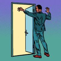 Pop art african man opens the door, greeting