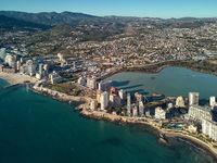 Aerial photo Calpe spit between Mediterranean Sea and lake. Spain