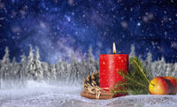 Candle with christmas decoration and starry sky