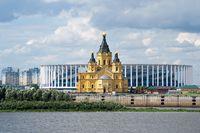 Alexander Nevsky Church on the background of the stadium built for the world Cup. Russia, Nizhny Novgorod, 22 Jul 2018