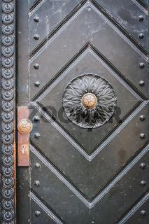 old door closeup - vintage building entrance door -