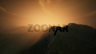 High mountain peaks covered with dramatic heavy fog