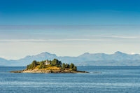Guard Island and lighthouse at entrance to Tongass Narrows, early morning near Ketchikan, Alaska.