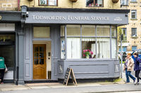 Todmorden / England - May 04 2018 : The funeral service is working from the centre of Todmorden which meaning is death killing or slaughtering in German