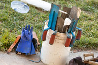 Bucket of Cement Trowels and Tools
